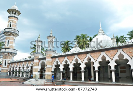 Historic mosque, Masjid Jamek at Kuala Lumpur, Malaysia during rain cloud moving - stock photo
