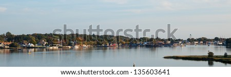Historic Mystic Seaport in Connecticut in evening light, panorama - stock photo