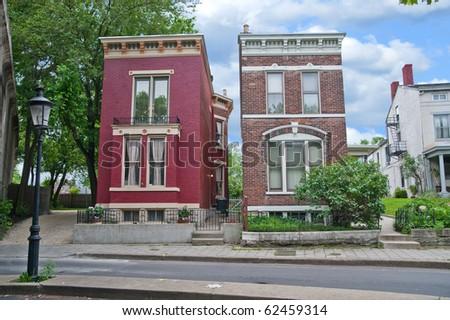Historic nineteenth century Italianate style homes in an old German neighborhood in Kentucky, USA. - stock photo
