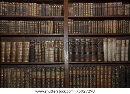 historic old books in a old library - stock photo
