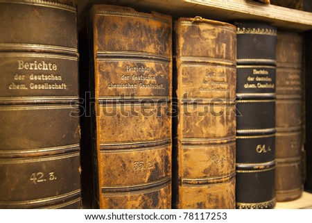 historic old books in line - stock photo