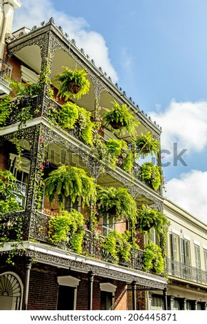 historic old buildings with iron balconies in French Quarter - stock photo