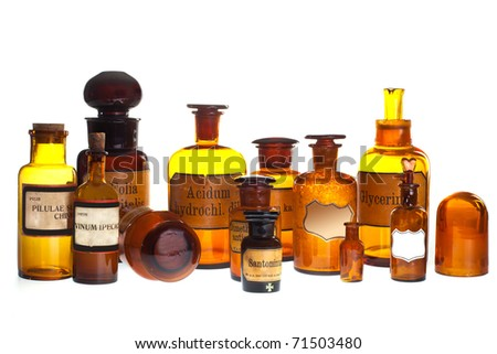historic old pharmacy bottles with label on white background - stock photo