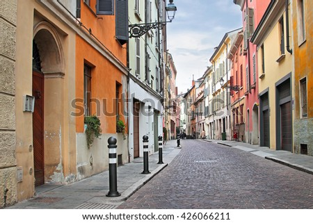 Historic old street with beautiful architecture in Parma, Emilia-Romagna province, Italy. - stock photo