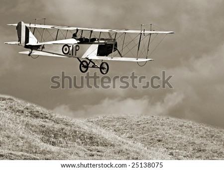 Historic plane above meadows - marking is fictive - stock photo