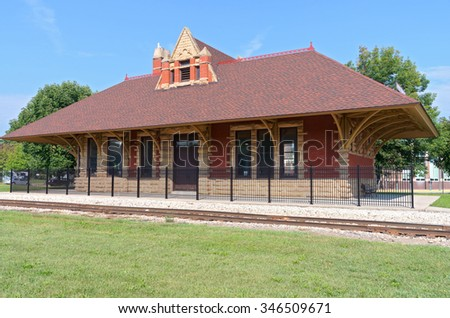 historic railroad depot building of high victorian gothic architecture style in whitewater wisconsin - stock photo