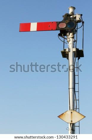 Historic red home British railway signal. - stock photo