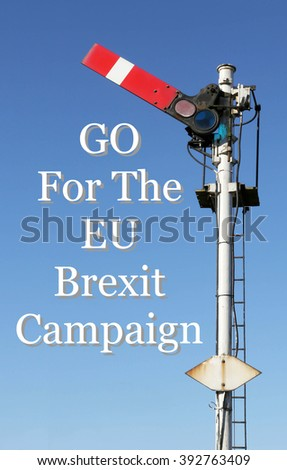Historic red home British railway signal in the start position with an Inspirational motivational quote of Go For The EU Brexit Campaign against a clear blue sky background. - stock photo