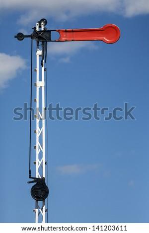 Historic red  railway signal. - stock photo