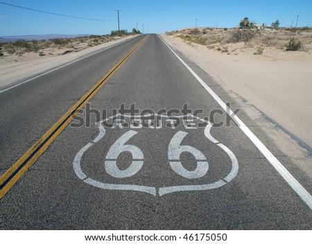 Historic Route 66 crossing California's mojave desert. - stock photo