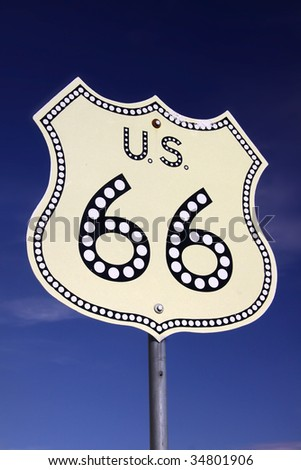 Historic route 66 road sign against blue sky - stock photo