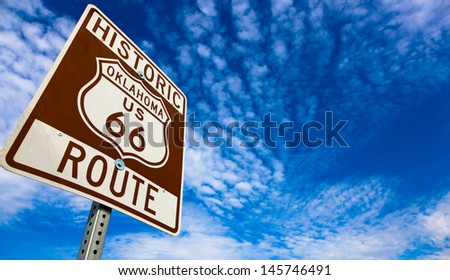 Historic Route 66 road sign on a blue sky - stock photo