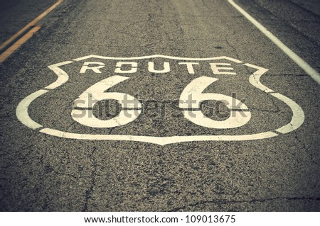 historic Route 66 sign on asphalt road at national trails highway, vintage style, California, USA - stock photo
