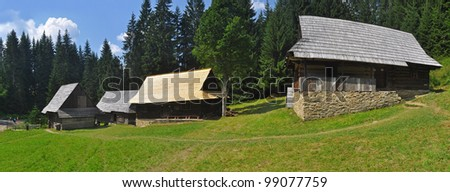 historic rural wooden houses panorama, photo taken in an open-air museum in Vychylovka, Slovakia. - stock photo