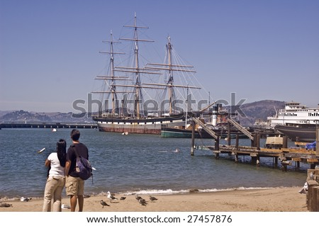 Historic ships in San Francisco Bay - San Francisco National Maritime Park - stock photo