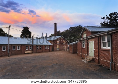 Historic site of Quarantine station on Sydney's North Head well preserved from colonisation times. Authentic gravel square surrounded by brick buildings and houses of modern museum - stock photo