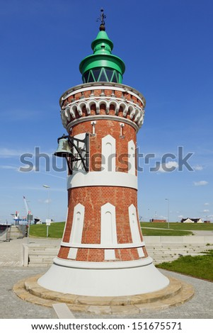 Historic small lighthouse at the entrance of Bremerhaven harbor, called Pingelturm - stock photo