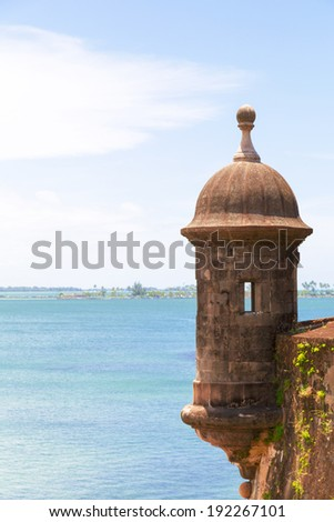 Historic Spanish lookout tower by San Juan Bay in Puerto Rico - stock photo