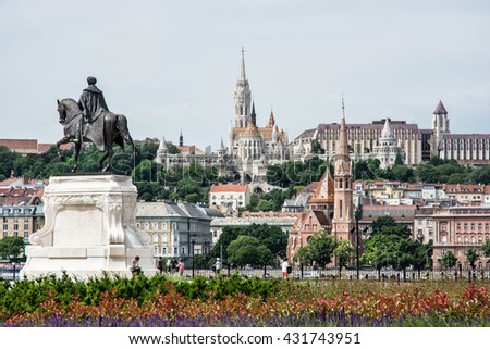 Historic statue, Matthias church, Fishermans bastion and Calvinist church in Budapest, Hungary. Cultural heritage. Architectural theme. Memorial place. Greenery and old famous city. - stock photo