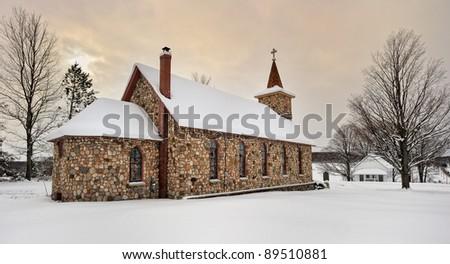 Historic Stone Church in Winter. East Jordan Michigan, USA - stock photo