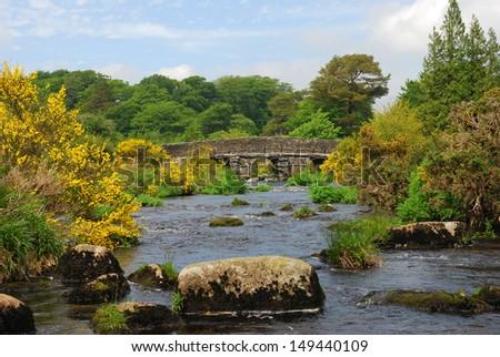 Historic stone clapper bridge in Dartmoor National Park, England - stock photo
