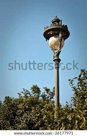 Historic street light in the streets of Barcelona, Spain.