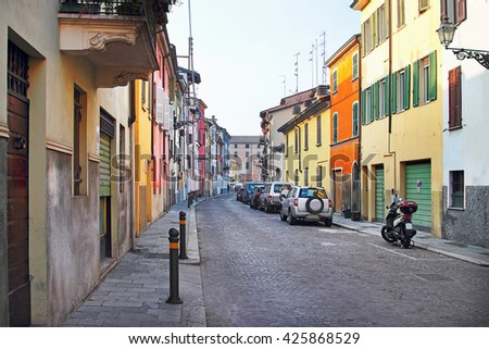 Historic street with many colorful houses in Parma, Emilia Romagna region, Italy. - stock photo