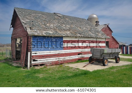 Historic Town old farming equipment and lumber house. - stock photo