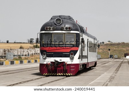 historic train locomotive restored to the original state on rails in the testing phase - stock photo
