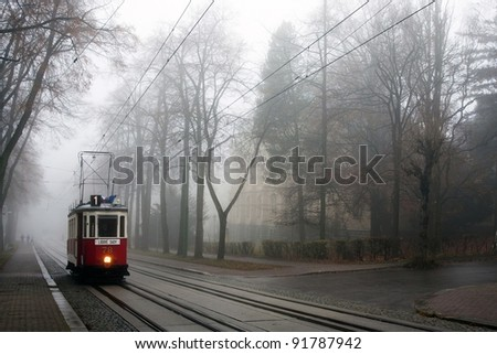 Historic tram in the fog - stock photo