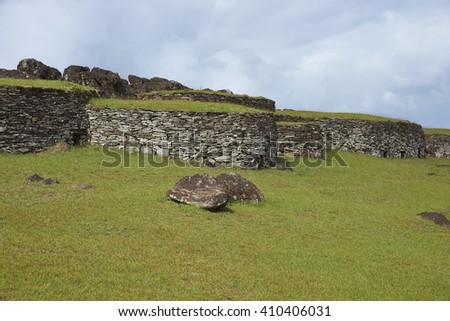 Historic village of Orongo, located on the rim of the extinct volcano Rano Kau on Easter Island. - stock photo