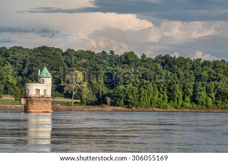Historic water intake tower number 1 built in 1894 below the Old Chain of Rocks bridge on the Mississippi River near St Louis - stock photo
