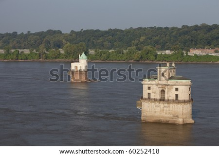 historic water towers (water intake)  on the Mississippi River above St Louis as seen from the old Chain of Rocks bridge - stock photo