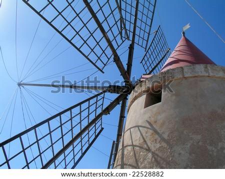 Historic wind mill under blue sky - stock photo