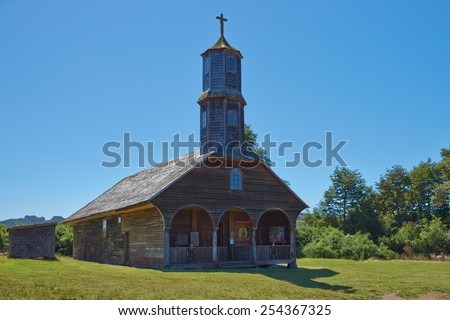 Historic wooden church, Iglesia de Colo, built in the 17th century by Jesuit missionaries on the island of Chiloe in Chile. - stock photo