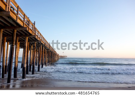 Historic wooden pier in city of San Buena Ventura at golden hour, Southern California