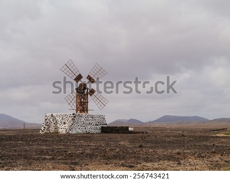 Historic wooden wind mill near the village Puerto Lajas on the Spanish island Fuerteventura one of the Canary islands in the Atlantic Ocean belonging to Spain - stock photo