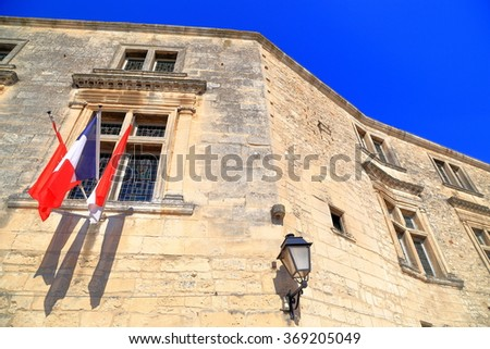 Historical building with French national flag on the facade in Les Baux de Provence, Provence, France - stock photo