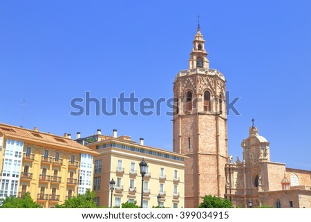 Historical buildings and distant Metropolitan Cathedral - Basilica of the Assumption of Our Lady of Valencia (known as Saint Mary's Cathedral or Valencia Cathedral), Valencia, Spain