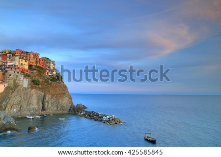 Historical buildings of Manarola harbor at dusk, Cinque Terre, Italy - stock photo