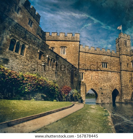 Historical Castle in Leeds Kent with Large Fluffy Clouds on a Sunny Day - stock photo
