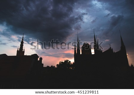 Historical center of Gdansk, town hall and St. Mary's Church silhuettes at sunset - stock photo