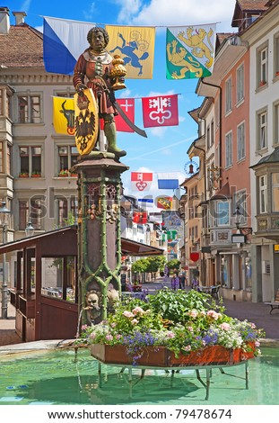 Historical center of Schaffhausen decorated with swiss cantons flags for the Swiss National day (1st August) - stock photo
