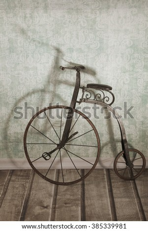 Historical children's high-wheel bicycle - stock photo