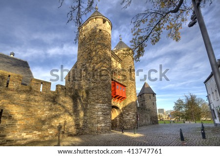 Historical city gate Helpoort with parts of the old city wall in Maastricht, Holland