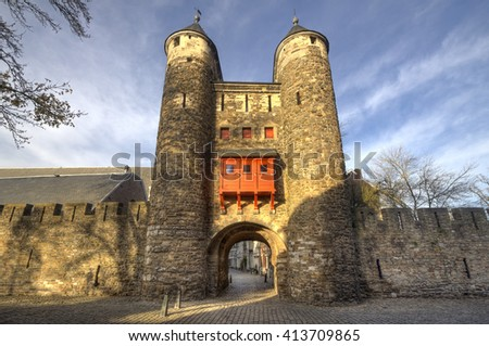 Historical city gate Helpoort with parts of the old city wall in the evening sunlight in Maastricht, Holland