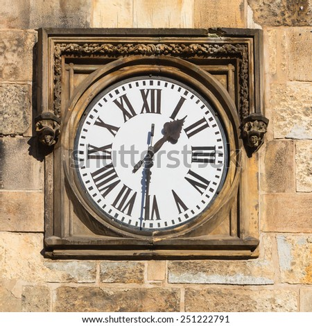 Historical clock in a stone wall - stock photo