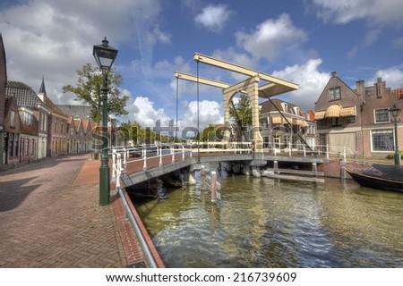 Historical drawbridge across a canal in Alkmaar, Holland - stock photo