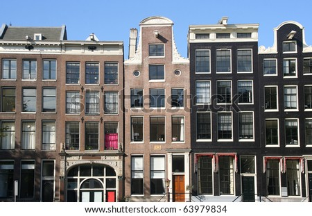 Historical houses along Amsterdam canal, Holland - stock photo