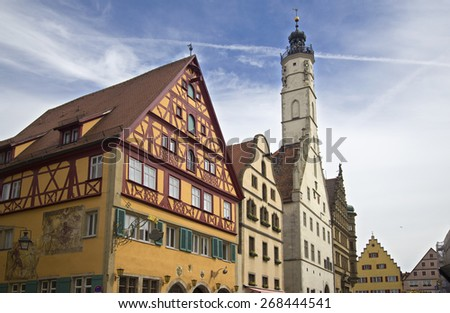 Historical houses and the tower of the old city hall of Rothenburg ob der Tauber, Germany - stock photo